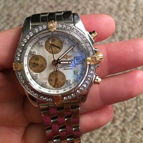 Breitling women's watch Authentic with papers, box, everything. Diamond bezel. Need to sell for wedding since I don't wear anymore. I also have the extra links. Rolex Jewelry