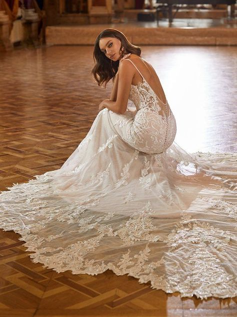 Look beautiful as ever in Val Stefani Style Dolce. This ornate lace mermaid wedding dress features a deep illusion v-back and thin beaded straps for a sexy style. Glamorous details like glas beads with sequins and a sparkle tulle fabric make this gown sparkle effortlessly all night long. #weddingdress #weddingdressideas #weddinggowns #mermaidweddingdress
