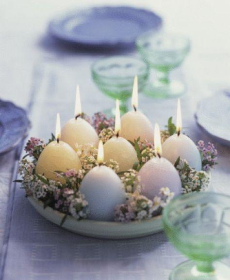 Egg-shaped candles set a warm, festive mood