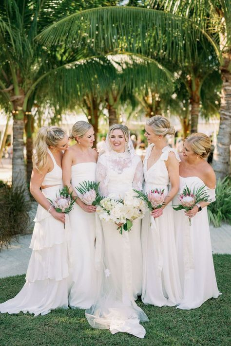 As guests walked from one side of the island to the other for the ceremony to the reception (yup, the island is THAT small), they were greeted by a one-of-a-kind night. 🌴 Head to stylemepretty.com to read on! LBB Photography: @hunterryanphoto #stylemepretty #tropicalwedding #islandwedding #floridawedding #bridesmaids