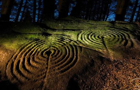 The 5,000-year-old Neolithic carvings of concentric circles, interlocking rings and hollowed cups were uncovered as part of a four-year English Heritage-funded initiative, in partnership with Northumberland and Durham County Councils, to record and publish online all the prehistoric rock art within the region  Picture: B. Kerr