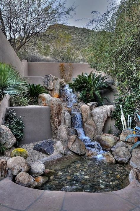 Backyard Landscaping Ideas - This luxury Arizona desert home combines waterscaping, xeriscaping and desertscaping to create a sustainable outdoor environment. It all starts with the rock water garden and waterfall at the front door.