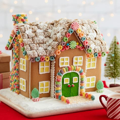 Welcome Home to the Most Amazing Cereal Gingerbread Manor Kelloggs® cereals and the Wilton® Gingerbread Manor Kit set your decorated gingerbread house apart from the rest this holiday season, as it is both a dessert and a decoration! Homemade Gingerbread House, Gingerbread House Candy, Graham Cracker Gingerbread House, Gingerbread House Template, Gingerbread House Designs, Gingerbread Village, Gingerbread Decorations, Gingerbread House Decorating Ideas, Gingerbread Cookies