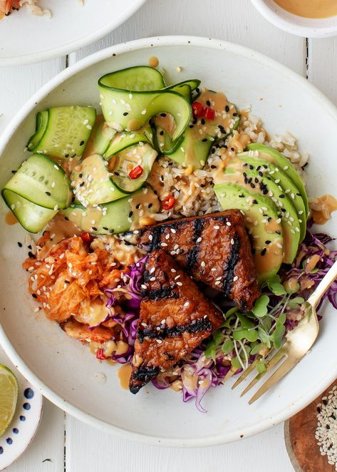 These vegan Buddha bowls are SO delicious and fun to eat! Piled with savory grilled tempeh, fresh veggies, avocado, kimchi, and peanut sauce, they're healthy, satisfying, and filled with flavor. | Love and Lemons #vegan #cleaneating #lunch #dinnerideas #meatless