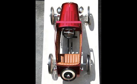 1932 Ford B-400 custom pedal car built by Steve's Auto Restoration. Set to be auctioned at Pebble Beach 2012, proceeds support the Petersen Free School Bus program. 2 additional sets of 3 pedal cars will be auctioned, respectively, at Barrett-Jackson & Amelia Island next year.