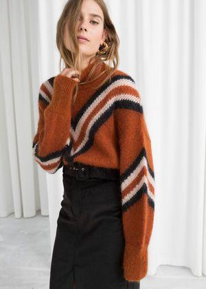 Model front image of Stories mock neck varsity stripe sweater in beige
