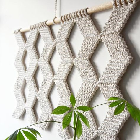 ●DESCRIPTION This wall hanging is MADE TO ORDER. It will take 1-2 weeks to create this wall hanging for you. This gorgeous macrame wall hanging is handmade with 100% high quality twisted cotton cord. With its unique geometric design, itll be an impressive addition to your interior I am 100% sure it