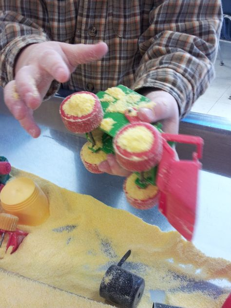 Play, Learn & Do in Preschool - cornmeal and construction trucks, a perfect combination