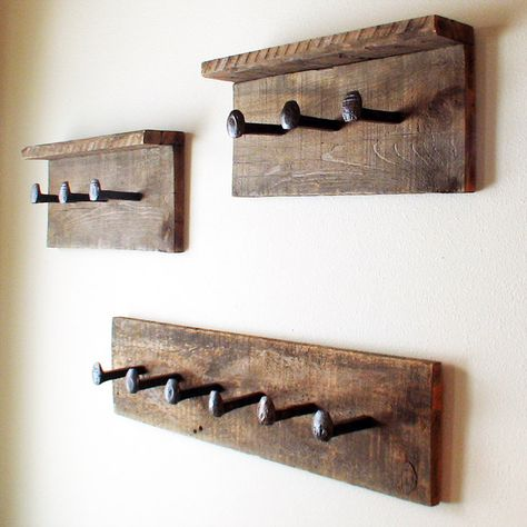 Rustic coat rack. Barn wood wall hanger. Railroad spike hooks. Reclaimed wood towel rack