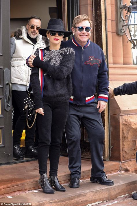 Festive outing: Lady Gaga, 28, joined Elton John, 69, and David Furnish, 54, for Christmas...