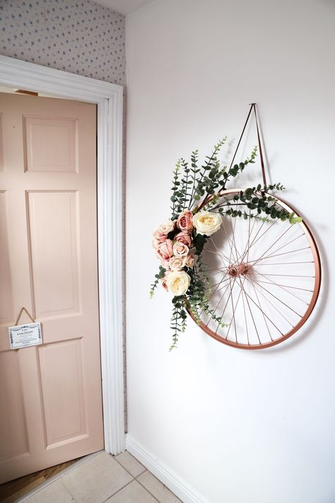 Repurpose And Recycle An Old Bike Wheel. In today's post, I am going to repurpose and recycle an old bike wheel. Using some Rust-oleum bright copper spray paint and some faux flowers I made this wreath. Perfect wedding DIY.