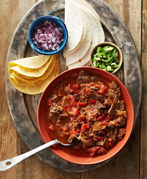 Think of this simple Mexican beef recipe as the starter pack for a DIY taco station. Use your Dutch oven to simmer beef roast with chorizo and chipotle pepper until fork-tender. Serve the family-friendly Mexican dish with queso fresco, jalapeño slices, and tortillas. #mexicanfoodrecipes #easy #best #bhg
