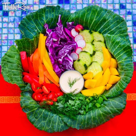 When you plant a seed of health, it is YOU that blossoms!  I built my FullyRaw salad tonight in a head of cabbage!  I filled it with chopped kale, rainbow bell peppers, purple cabbage, mango slices, cucumber, pink radishes, cherry tomatoes, and green onions with a creamy hemp dill dressing! May your health blossom!