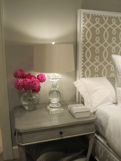 DITTO: Another Pinner said: Love that head board! Really like the clear based lamp and the gray wall. So clean an beautiful with white