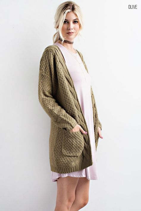 31ae50eb13 This Cable Knit Cardigan Sweater is so on trend this season! This cozy  slightly oversized sweater is soft and features an open front with two  front pockets.