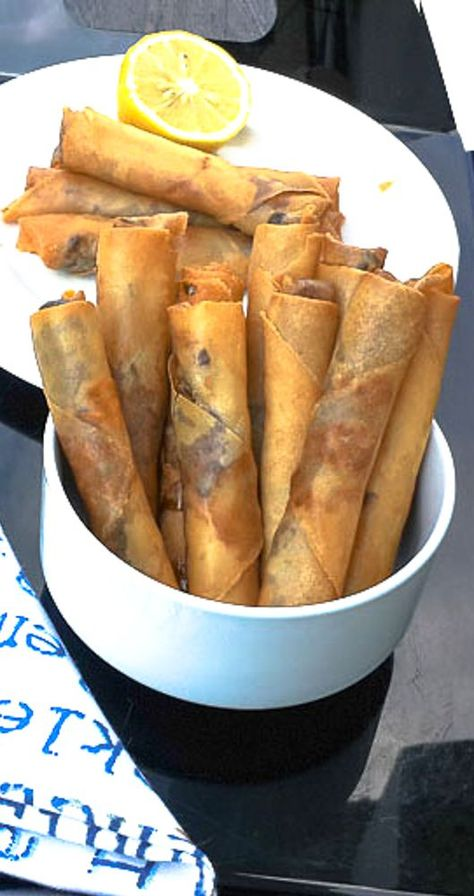 Lebanese Meat Rolls The rolls are ideal for parties, gatherings and they look great on your holiday buffet. When Imake them, I usually double the quantity because they freeze perfectly; and the good news is that they can go directly from freezer to fryer. Middle East Food, Middle Eastern Dishes, Middle Eastern Recipes, Lebanese Cuisine, Lebanese Recipes, Meat Appetizers, Appetizer Recipes, Indian Appetizers, Indian Snacks
