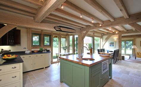 This spacious and elegant kitchen is open plan to the entrance hall and has long views through to the lounge beyond. The ceilings, in this area only, have oak secondary joists creating a farmhouse style room.