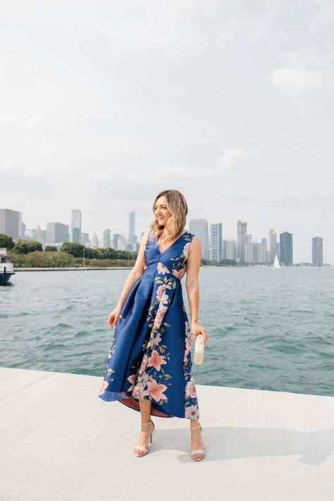 0ad3204a8a6 Chicago blogger Jessica Sturdy wearing a pink and blue floral dress by Lake  Michigan with the skyline in the background.