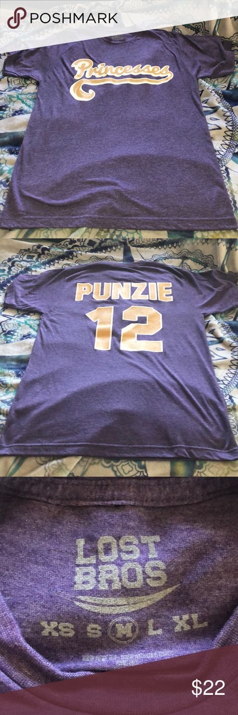 The Lost Bros Punzie T-Shirt The Lost Bros. Punzie Jersey T-Shirt.   Size Unisex Medium.  Only worn once.  No visible holes or stains.  Comes from a smoke free pet friendly home. Tops Tees - Short Sleeve