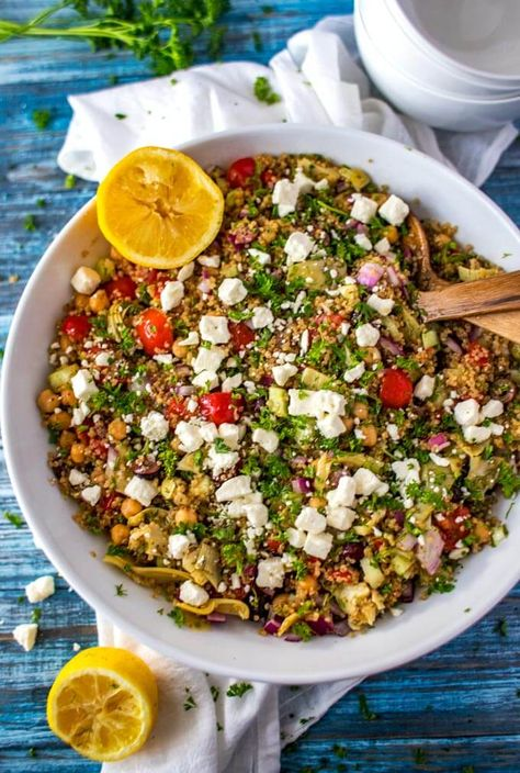 You will fall in love with this healthy Mediterranean Quinoa Salad! This easy recipe is protein packed thanks to chickpeas, feta, and quinoa and is perfect to make ahead for lunches. #wendypolisi #vegetarian #easysalad #quinoasalad #MediterraneanQuinoaSalad #GreekQuinoaSalad