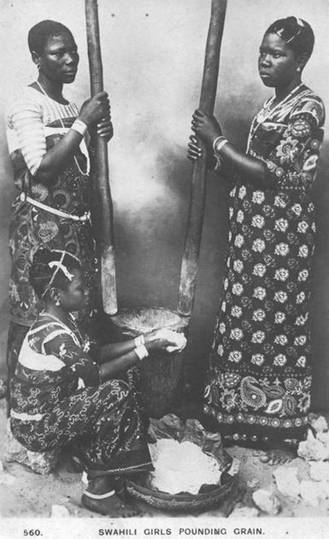 Africa | Swahili girls pounding grain.  || Vintage Postcard; photographers  C.D. Patel and Sons