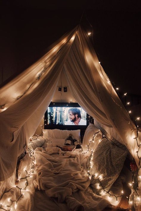 Date night and a movie under a romantic lit fort blanket | Date night ideas for couples #datenight #romantic