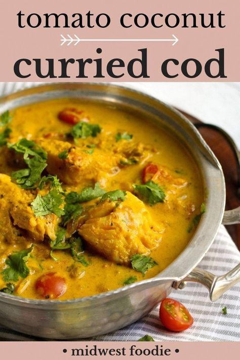 Tomato Coconut Curried Cod -- Snuggle up with a big bowl this curried cod immediately! Any mild white fish will work in this healthy curried cod recipe. The combination of tomato and coconut will ignite your tastebuds. Garnish with fresh cilantro and serve with a big bowl of rice! #midwestfoodie #curry #fish #healthy #mealprep #familydinner #tomato #cod #coconut via @midwestfoodiegirl