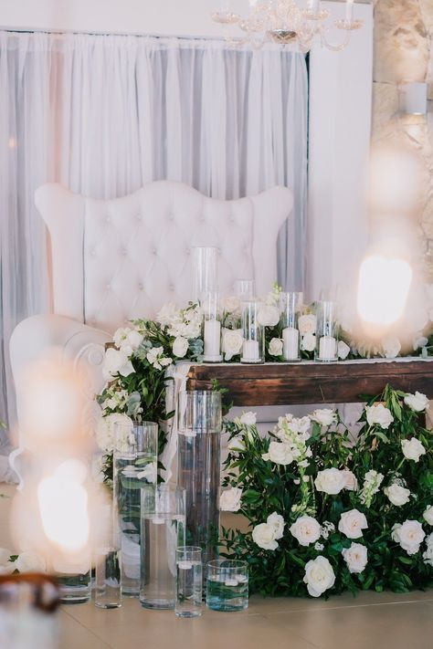 Rustic wedding sweetheart table designed so the base would be covered but it did not fail to be over the top gorgeous. With a love sofa, gorgeous greenery/flowers and candles everywhere... its beautiful! Design by Kukua Wedding Team | Photo by Punta Cana Photographer | #sweethearttable #romanticwedding #rusticweddingchic #theweddingbliss #instawedding #gettingmarried #modernwedding #rusticweddingdecor #rusticweddings #weddingdayready #rusticwedding #chicwedding