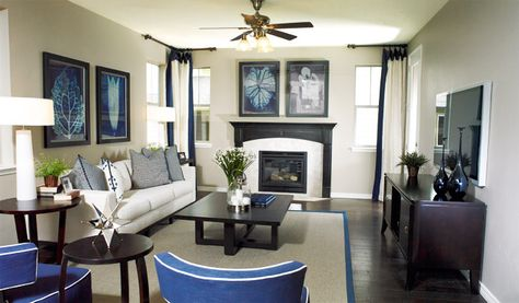 Navy accents and dark wood tones add sophistication to this living room.