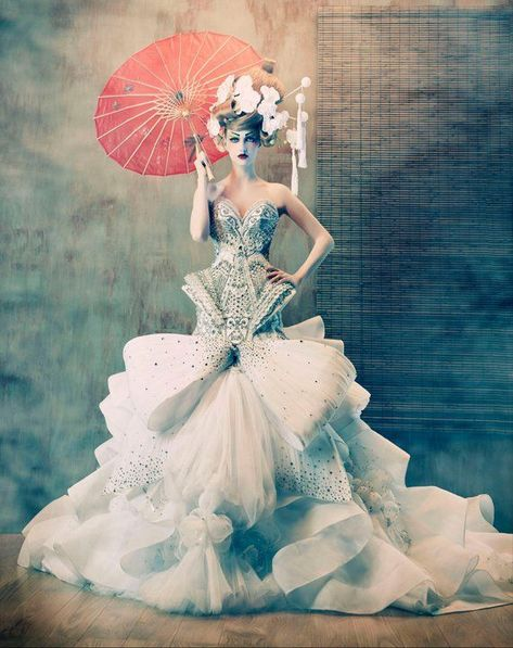 Looks like a high fashion couture wedding gown splashed… Simply gorgeous couture. Looks like a high fashion couture wedding gown splashed with some East Asian accents.