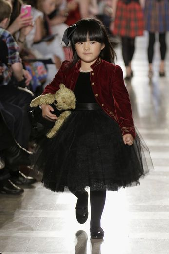 Angela Wang walks the runway at the Ralph Lauren Fall 14 Children's Fashion Show in Support of Literacy at New York Public Library on May 2014 in New York City.