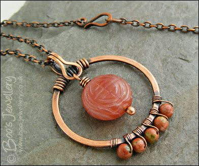 Carnelian and unakite copper circle pendant on chain. Love that the bail doubles as a loop to hold the dangle!