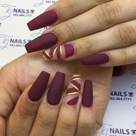 Cute matte burgundy coffin nails with gold striped accent nail! - Don't miss the full article and visit