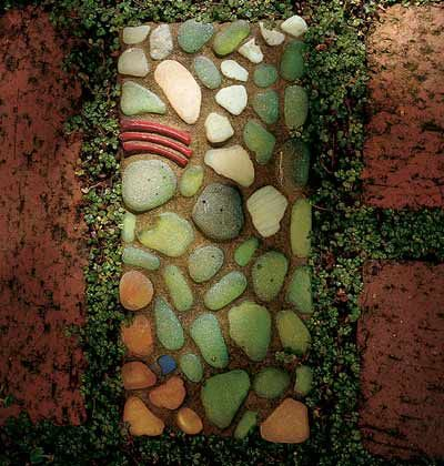 """""""pavers with personality"""" ~ made with found objects:  glass, shell, stone, pottery"""