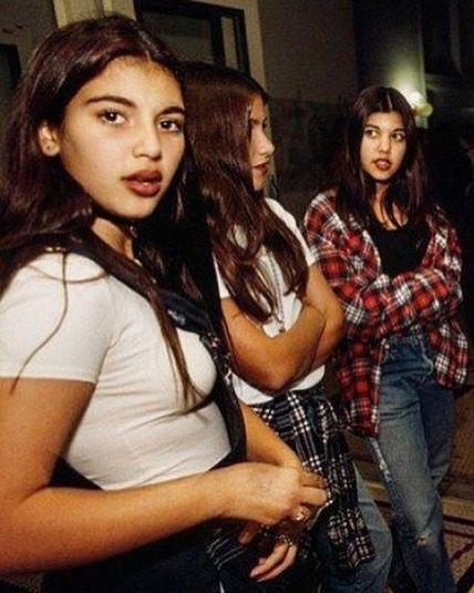 At least it did for Kim and Kourtney Kardashian as they were totally down with the grunge trend in the We've got the classic throwback pic in their jeans and flannel shirts, right here!