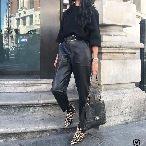 Shop our new Black faux leather paperbag waist trousers at River Island today.