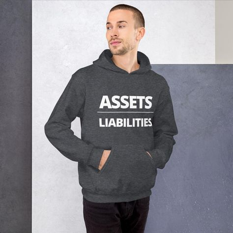 Always remember: Assets over Liabilities. Everyone needs a cozy go-to hoodie to curl up in, so go for one that's soft, smooth, and stylish. It's the perfect choice for cooler evenings! • 50% cotton, 50% polyester • Double-lined hood • Double-needle stitching throughout • Air-jet spun yarn with a soft feel and reduced pilling • 1x1 athletic rib knit cuffs and waistband with spandex • Front pouch pocket Size guide S M L XL 2XL Length (inches) 27 28 29 30 31 Width (inches) 20 22 24 26 28