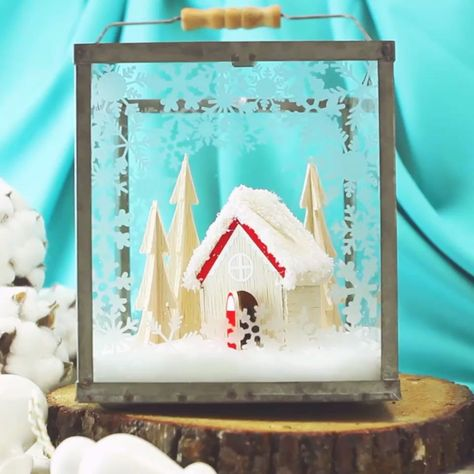 This Christmas Terrarium DIY features wooden elements for a different look. With step by step instructions and lots of pictures this holiday decoration comes together quickly. #christmascraftsdiy #christmasdecor #christmasdecorationideas #cricutmade #cricutcrafts #cricutmaker #holiday decor diy videos Christmas snow terrarium