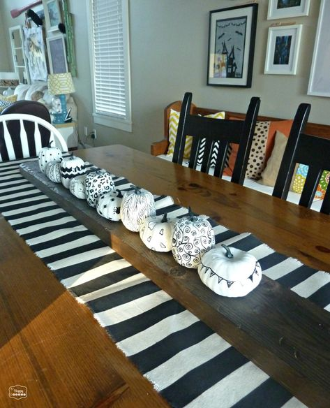 Easy DIY Black and White Dropcloth Table Runner {& 8 Fab Black & White Projects} - The Happy Housie.  Rustic wood over painted table runner.  Neat idea. ~