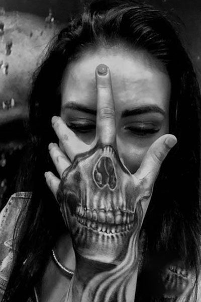 25 Cool Hand Tattoos For Those Who Love Ink In 2020 Hand Tattoos For Guys Skull Hand Tattoo Skeleton Hand Tattoo