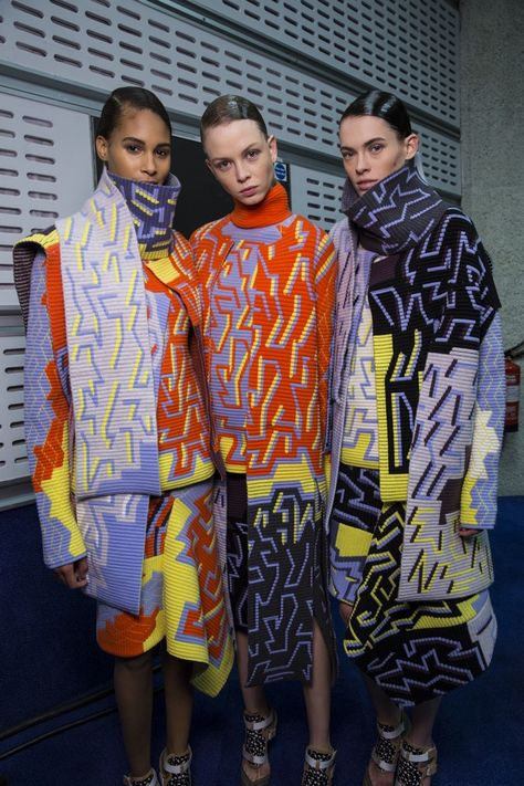 The contrast of a geometric print with the soft fabric of knitwear is innovative. This designer has used contrasting colour blocking. Clashing geometric knits backstage at Peter Pilotto for
