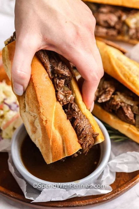 This french dip recipe is made in the slow cooker and turns out perfect every time. BY slow roasting the chuck roast in beef broth and seasoning this tender beef makes the best sandwich    especially served with sides like coleslaw and oven fries! #spendwithpennies #frenchdip #slowcooker #crockpot #sandwich #easybeefrecipe #sandwichrecipe #chuck beef recipe French Dip Sandwich {Great for a Crowd!} - Spend With Pennies