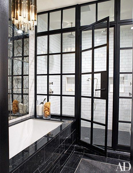 Floor length black-trimmed shower trim and white tiling in Neil Patrick Harris and David Burtka's NY home.