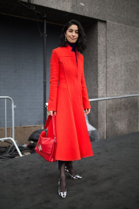 Caroline Issa is seen on the street attending Jason Wu during New York Fashion Week wearing a bright red coat on February 9 2018 in New York City