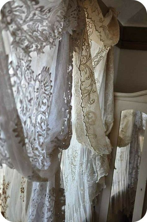 Lace curtains be cool to do to add either bohemian or victorian to a cookie cutter rv - even a toile