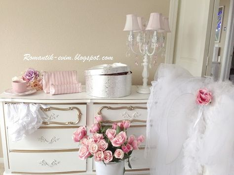 vintage style & colors for baby room...pale pink, beige, white. perfect.