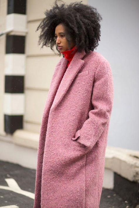 Julia Sarr-Jamois at London Fashion Week, wearing an oversized boucle menswear-style coat with a red turtleneck.