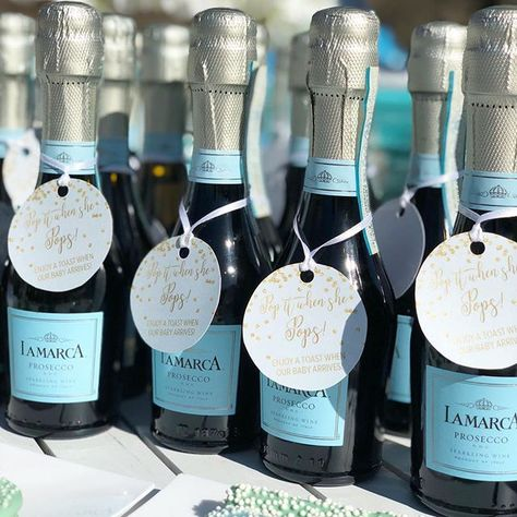 """Prosecco favors for guest to celebrate when the baby is born - """"Pop it when she pops"""". 🥂CHEERS to a beautiful baby shower. 🤱 #babyshowers #babyshowerideas #babyshowerfavor #partyplanner #eventplanner #procecco"""