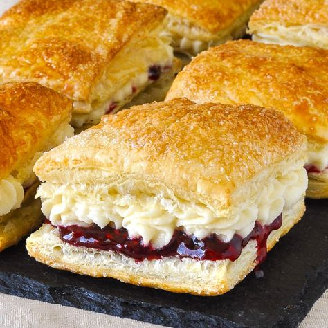 Homemade Flakies with raspberry compote & vanilla cream. A nostalgic tribute to the Vachon Flakie, one of my very favourite snack cake treats as a kid.#canada #canadianfood #puffpastry #puffpastryrecipes #easydessert