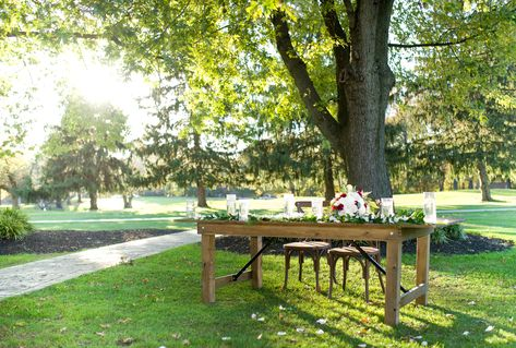 Rustic farmhouse table for the newly-wed couple @ Ramblewood Country Club. Decorate this table however you like to best fit your vision for your future wedding! #RonJaworskiWeddings #OutdoorWeddings #RusticWedding #WeddingVenue #NJWeddingVenue #NJWeddings #PAWeddings #PhillyWedding #WoodsyWeddingVenue